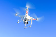 flying-drone-camera-blue-sky-mounted-digital-used-photographing-filming-64758778.jpg